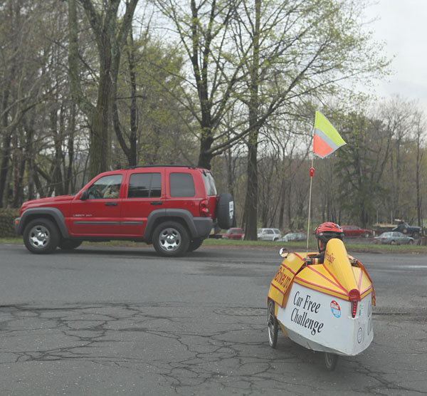 Merrill Gay rides his home-built recumbent tricycle velomobile, around New Britain on Earth Day. (4/22/09)