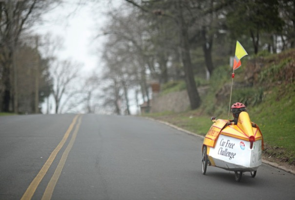 Merrill Gay rides his home-built recumbent tricycle, velomobile, around New Britain on Earth Day. (4/22/09)
