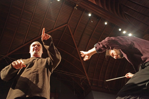 "Conductor Adrian Sylveen Mackiewicz, directs singer Laurentiu Rotaru and the Connecticut Virtuosi Chamber Orchestra, during the rehearsal for their Friday night concert, ""Freedom Calls"" at the Trinity on Main performance center. (5/12/09)"