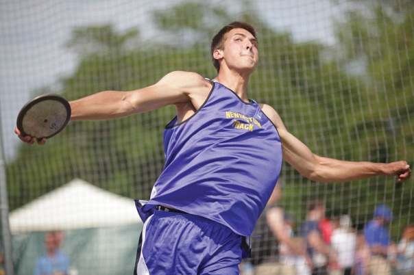 Newington senior Jack Kusinski throws discus in the track meet at Veteran's Stadium in New Britain.